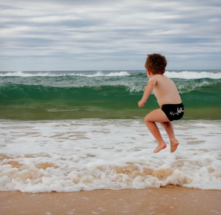 Charlie jumping at Rainbow beach